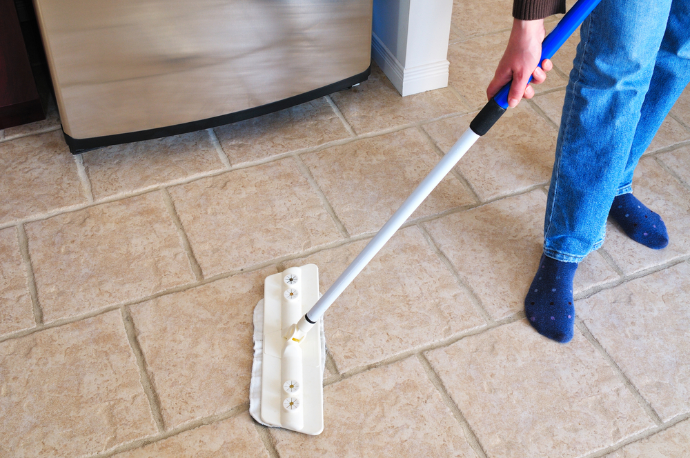 mopping a tile floor hillsborough floor coverings international