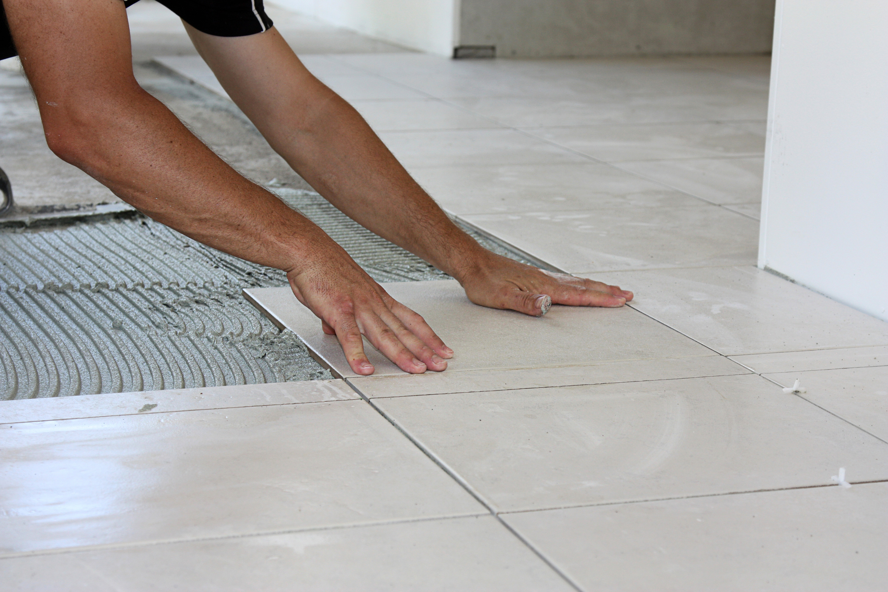 Tile flooring being installed to a kitchen in a home in Concord, CA