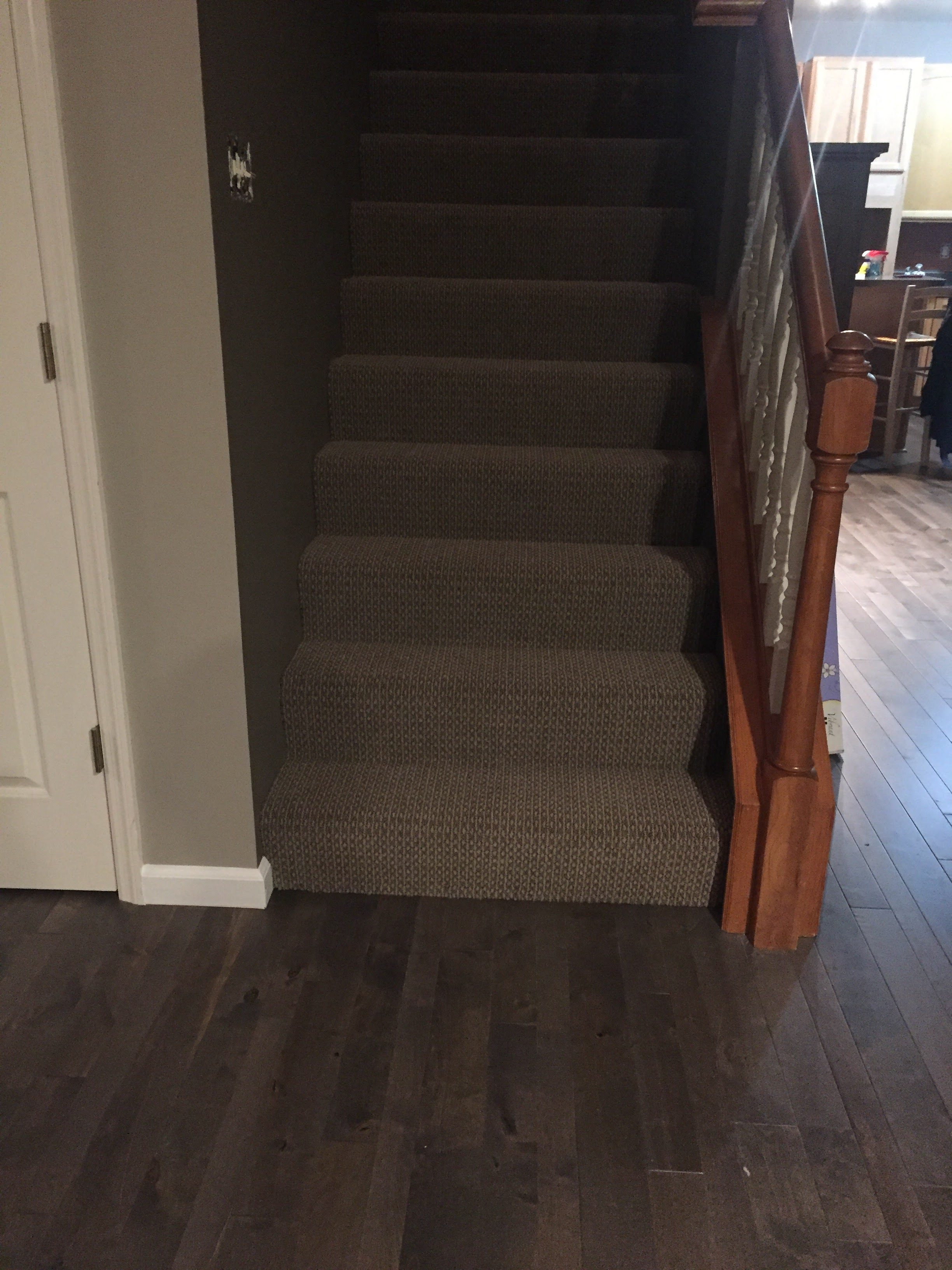 Hardwood floors and stair carpeting in West County