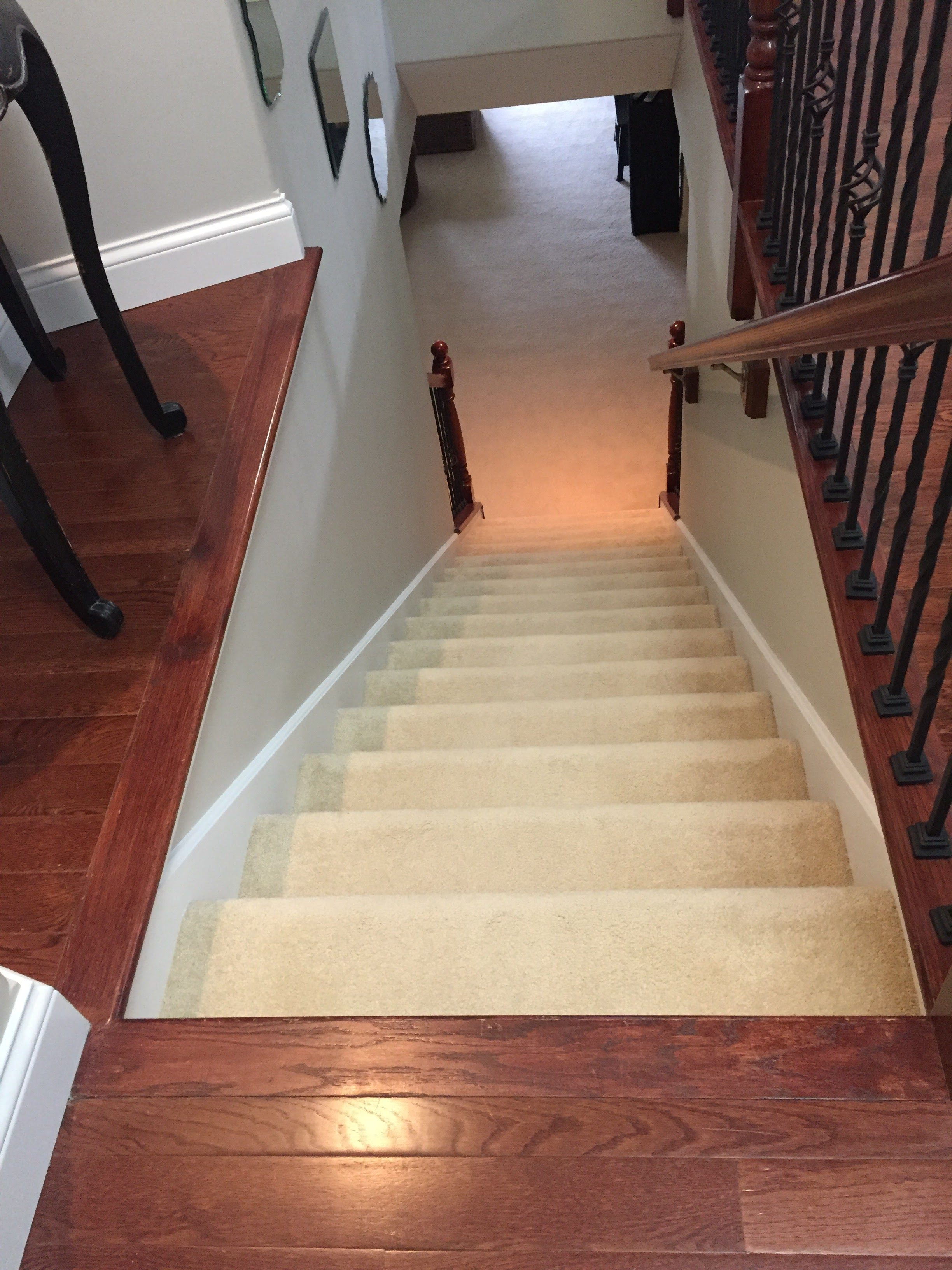 Luxury Vinyl Plank Floors and Refinished Stairs West County