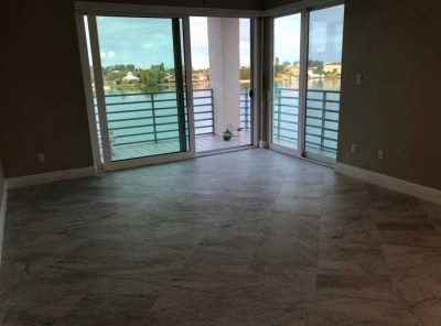 Windowed Balcony Room With Tile Flooring