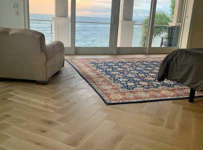 Zig-Zag Hardwood Floor Living Room Overlooking The Ocean