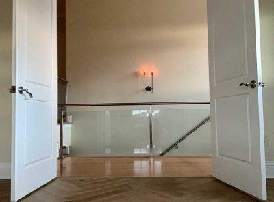 Zig-Zag Hardwood Floor Inside A Double-Door Room