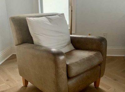 Zig-Zag Hardwood Floor Under A Leather Cushion Chair