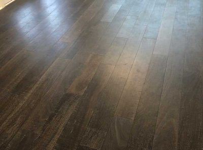 Dark Hardwood Floors Near The Back Patio Doors