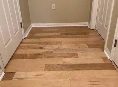 Patterned Hardwood Near A Bedroom Door