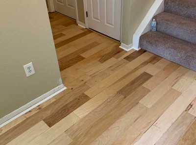Patterned Hardwood Adjacent To Carpeted Stairs