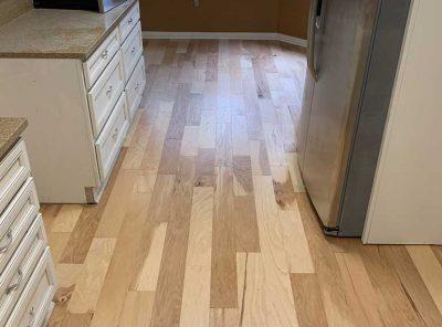 Granite Countertop Kitchen Floored With Hardwood