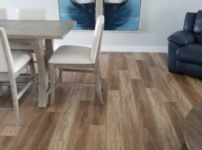 Mixed Light and Medium Colored Flooring Under The Kitchen Table