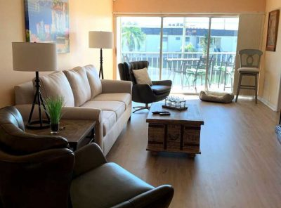 Uniform Light-Brown Floor Panels Stretching Across The Living Room